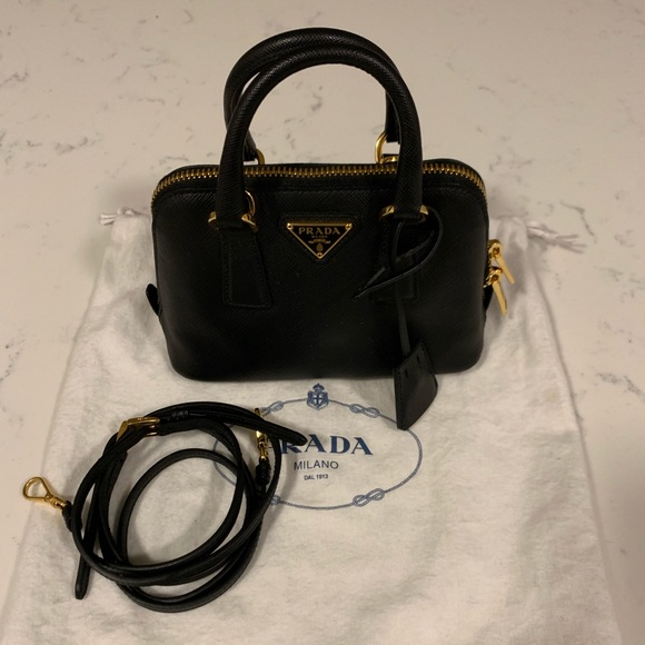 f028903e9aad Authentic Prada Promenade Saffiano Lux Mini. M_5caaa7887f617fb04849bd48